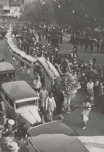 Carnival at Bendigo 1939 Elevated view of Chinese dragon in Bendigo street, crowd lining street watching
