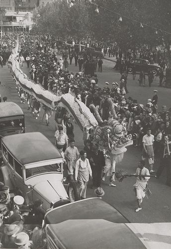Carnival at Bendigo 1939 Elevated view of Chinese dragon in Bendigo street, crowd lining street watching