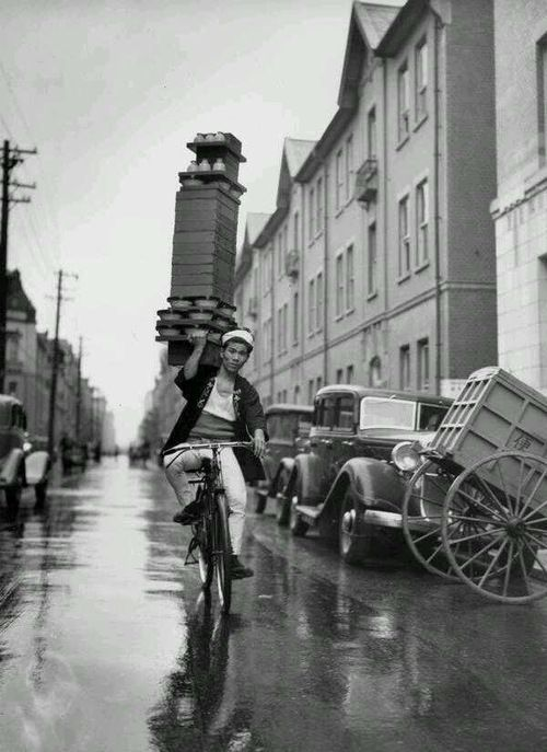 Amazing service… A delivery boy for a Tokyo Restaurant carries a tray of Soba Bowls,
