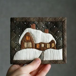 What a lovely little quilted house.  This is a purse, but could be hung as a picture in a doll house or enlarged to be a pot holder.