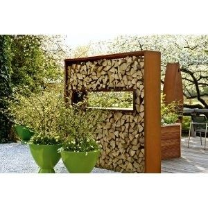 An artful idea for storage of fireplace wood... if it were deeper and well supported.    wood wall by estela