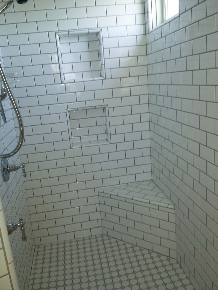 White Subway Tile With Grey Grout Seat And Niches In