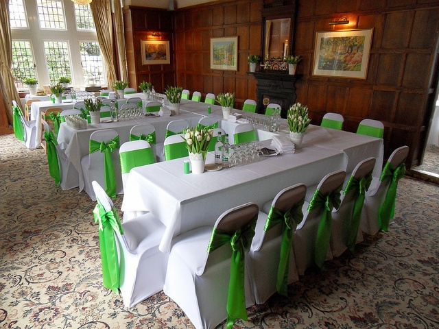 The Oak room is stunning Green E shape with photo from Beau Events