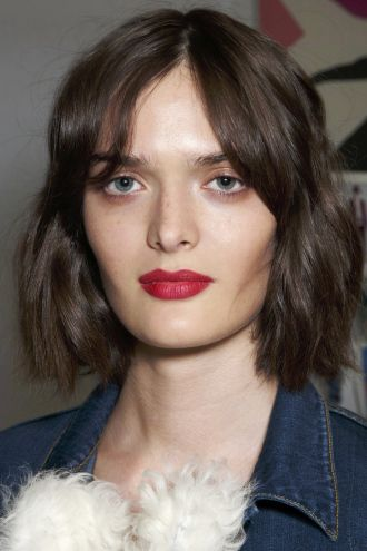 Medium-short-hairstyle-with-middle-part-bangs