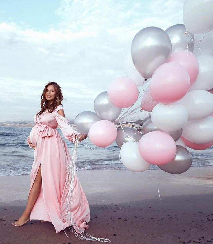 Pretty in pink beach Maternity shoot. Dress by @sadekmajedofficial Photography @…
