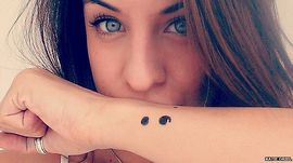 picture of women with semicolon tattoo