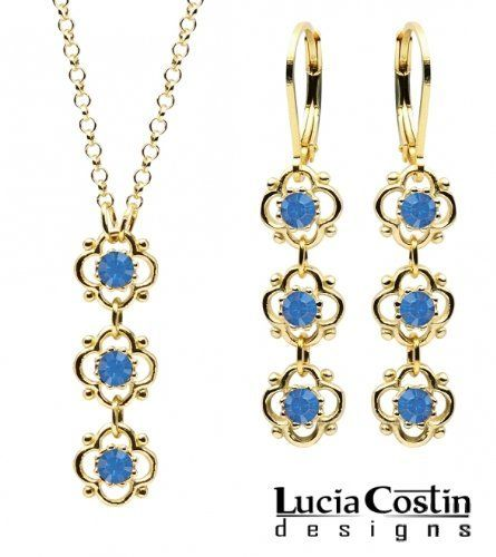 Enchanting Jewelry Set: Pendant and Earrings Designed by Lucia Costin with Blue Swarovski Crystals, 3 Cute Flowers and Dots; 14K Yellow Gold over .925 Sterling Silver; Handmade in USA Lucia Costin. $79.00. Produced delicately by hand, made in USA. Lucia Costin jewelry set. Delicate floral design. Beautifully designed with deep blue Swarovski crystals. Unique and feminine, perfect to wear for special occasions and evenings