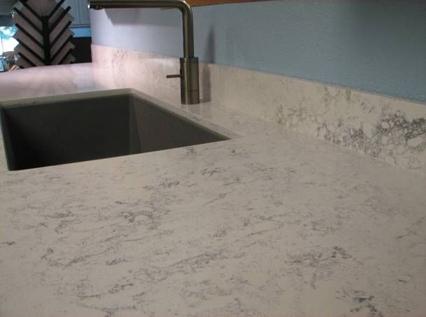 Silestone carrera marble caesarstone misty carrera vs for Silestone vs granite
