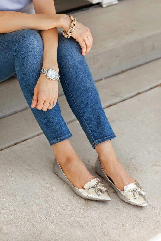 Tasseled flats, jeans