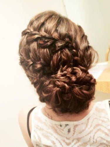 Long hair: multiple french braids woven into a chignon.