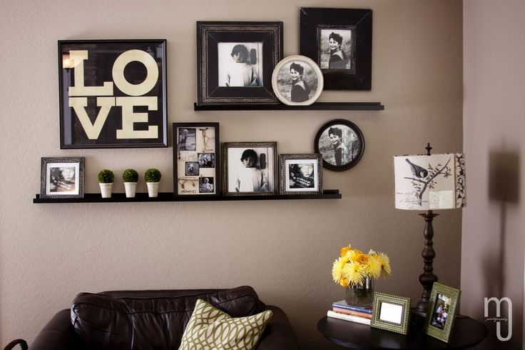 Love the arrangement of these shelves and frames over a sofa