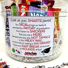Graduation Candy Bar Poem Gift Bucket $22.50   The perfect graduation gift! A clear plastic bucket is filled with 10 different candies that are featured on a cute congratulatory poem on the front.  Contents: Smarties Big Roll 2.2 oz. Skor Candy Bar 1.4 oz. PayDay Candy Bar 1.85 oz. Snickers Candy Bar 1.9 oz. Nerds Box 1.6 oz. Hot Tamales Theater Box 5 oz. Milky Way Candy Bar 1.84 oz. 100 Grand Candy Bar 1.5 oz. Reese's Fast Break Candy Bar 2 oz. Mounds Candy Bar 1.7 oz. Graduation Confetti