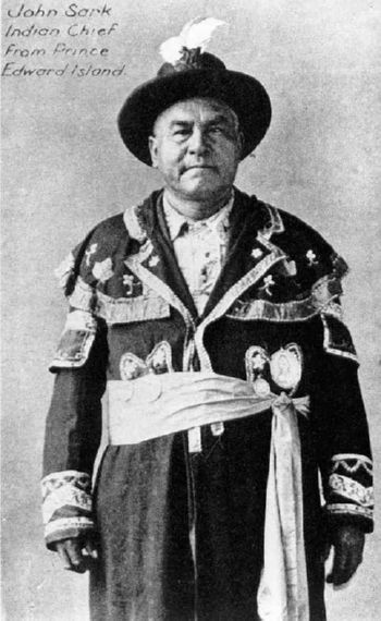 "Chief John Sark of Prince Edward Island was photographed between 15 and 21 July 1923, during the re-enactment and celebration of the 1773 landing of Scottish settlers at Pictou.   The original is labeled ""Micmac Chief, John Sark/Chief of Prince Edward Island/(with four Indian medals)/Photo taken during Hector Celebration, Pictou, N.S.; 15 July 1923 (from Standard, Montréal)."""