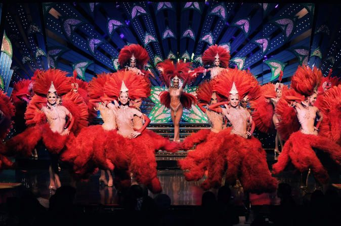 Moulin Rouge Late Night Show with Champagne Paint the town red and enjoy the glitz and glamour of the cabaret on this 2-hour late night show at the Moulin Rouge in Paris with Champagne. Watch world-renowned showgirls strut their stuff on stage. Marvel at dazzling costumes, fabulous stage design and spectacular show tunes. Sip Champagne and soak up the atmosphere in this historical cabaret venue. Pick up your ticket to the hottest show in town and make the most of your vacation...