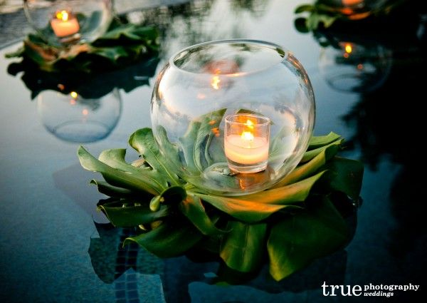 Floating-pool-candle-and-greenery-at-wedding