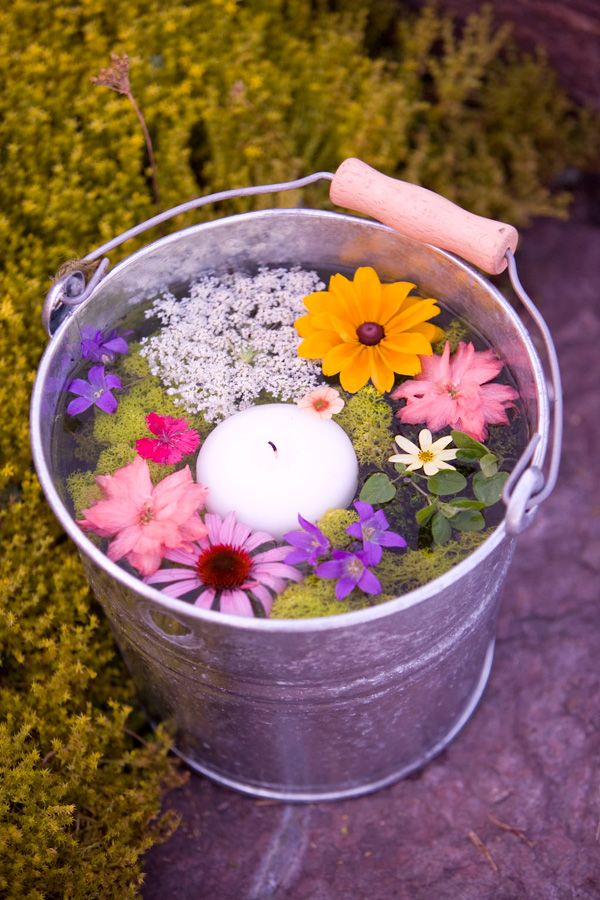 This is my favorite! For a casual surprise, pick colorful flowers and let float them in a can of water. Add a candle too and a few drop of favorite essence if appreciated. Reminds me of Rainbow in a bucket!