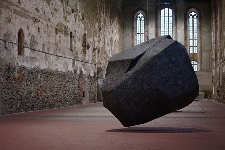 artists anna borgman and candy lenk have installed what appears to be a burdensome rock inside the chapel, but is actually a cleverly-concealed paper mache sculpture.