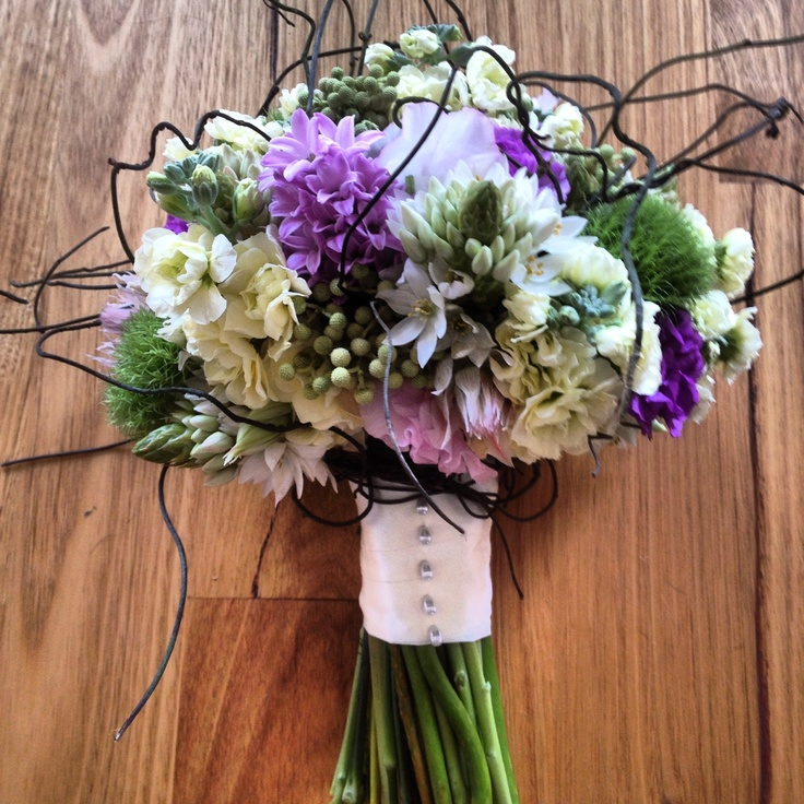 Purple, mauve, pink, lemon, lime & ivory wedding flowers, with vine. Bouquet for the bride.    www.RedEarthFlowers.com.au