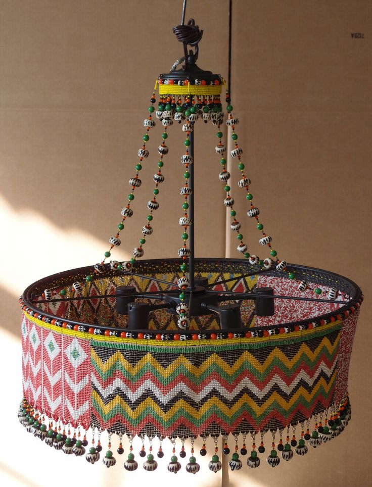 custom kirdi chandelier this uses three kirdi pieces and a myriad of african beads - Maroon Canopy Design