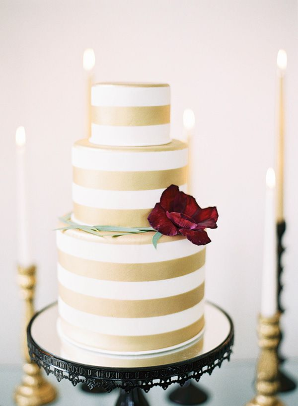 Gold and White Striped Cake with a Garnet Flower | Marissa Lambert Photography | http://heyweddinglady.com/modern-southern-glamour-preppy-stripes/