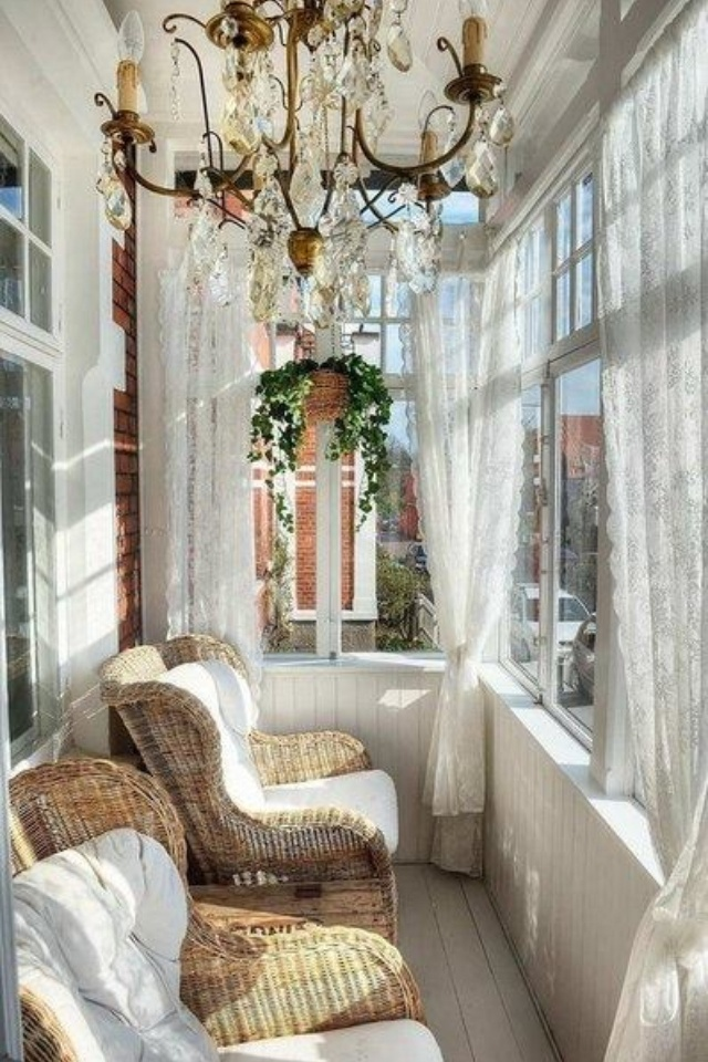 draped sun porch- curtains and chandelier add personality and warmth
