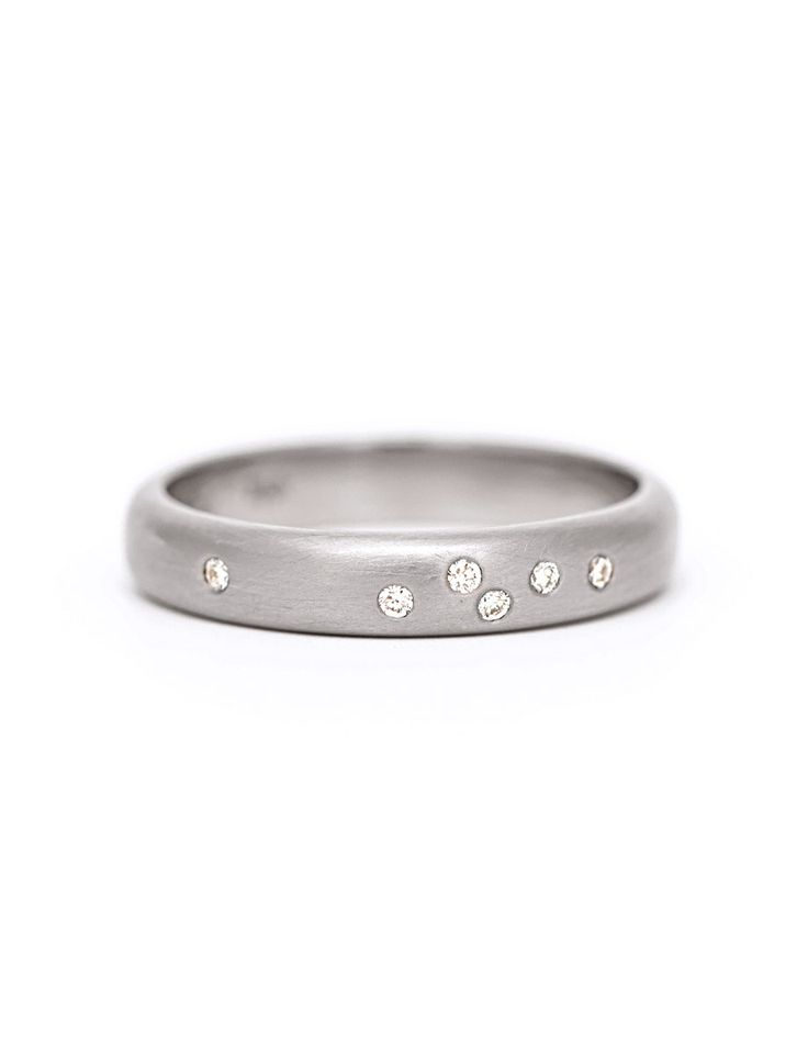 A celebratory sprinkling of diamonds in a brushed white gold band, handmade by Amy Renshaw. Shop Australian designed jewellery and engagement rings.