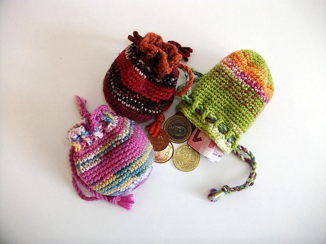 Crocheted pouch pattern on Ravelry - I really like these. I've made several of them as gifts as well as for myself, they are useful.