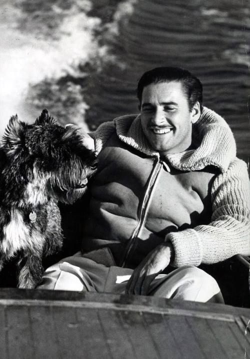 Errol Flynn and his dog Arno 1939