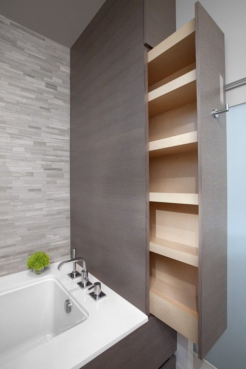 Cabinets. This is great! Hidden storage is always appealing. Any style could be worked for this and can be done at the tub as here in this picture, or in a small space in a bathroom. I can see it working similarly in a kitchen also.