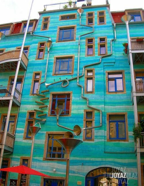 A BUILDING THAT PLAYS MUSIC WHEN IT RAINS !!!!    This building is located in Dresden, Germany. It's called Neustadt Kunsth of passage. And when it rains it starts to play music