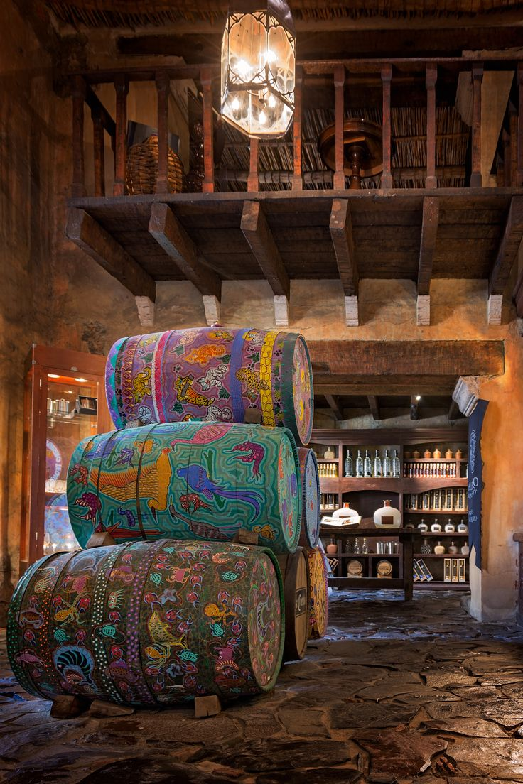 Jalisco, Mexico - Tequila store in Tequila town, Jalisco, Mexico~ I want to walk into this room and feel the stone under my feet, smell the wood, and look closely at the painted barrels.