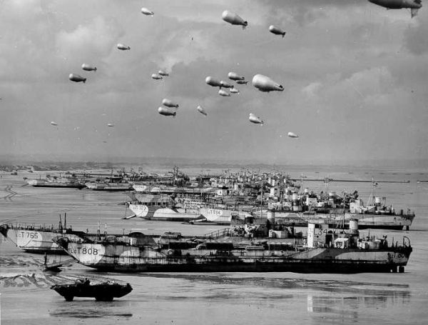 British landing craft and barrage balloons on the beach at Normandy, D-day, June 6, 1944