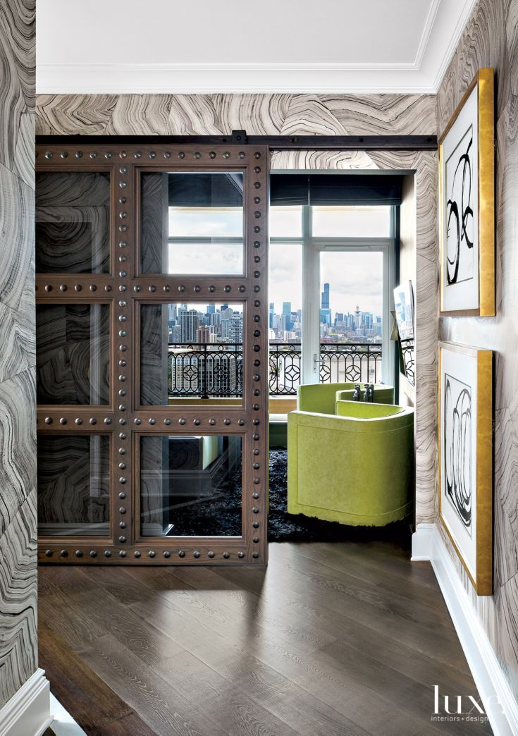 A Studded Glass Sliding Door Leads Into The Media Room A