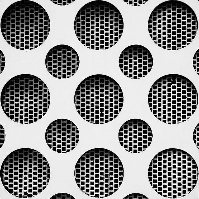 Monochrome circle & grid patterns in architecture