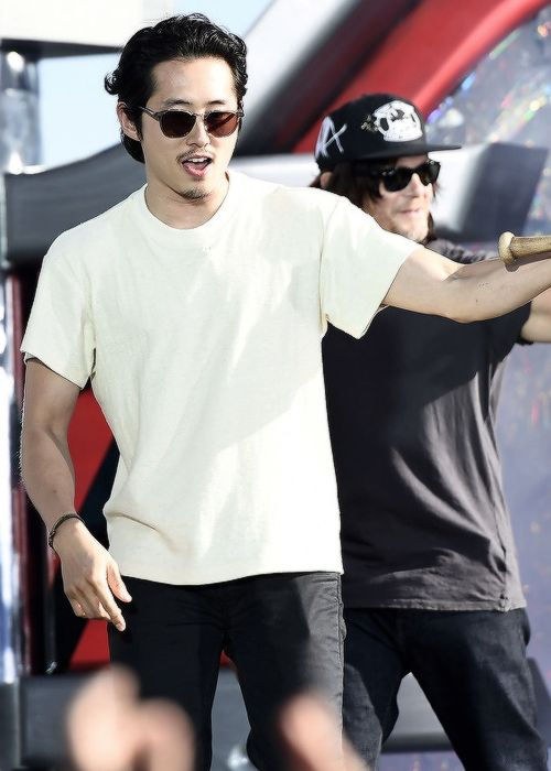 Steven Yeun and Norman Reedus during SyFy Live at Comic-Con International 2016 on July 22, 2016 in San Diego, California