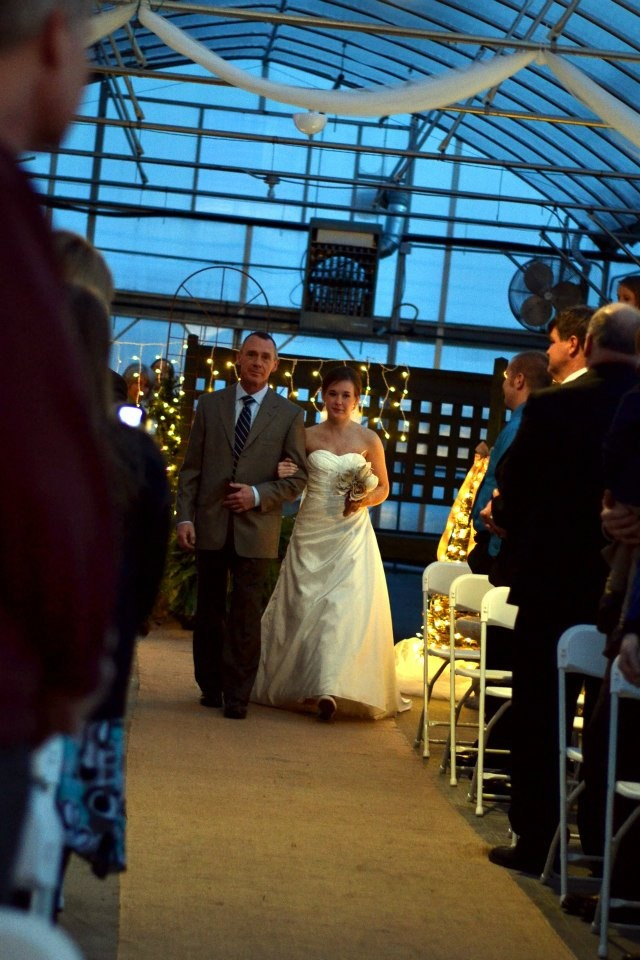 """Daddy and Callie while our son Charlie is playing """"Butterfly Waltz"""" for the processional."""