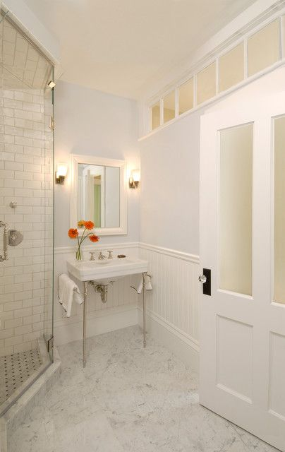 Add light to a bathroom with no windows  http://www.houzz.com/photos/938698/Greek-Revival-Bath-with-Transom-Windows-traditional-bathroom-boston