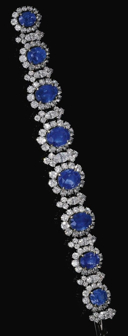 SAPPHIRE AND DIAMOND BRACELET, BULGARI, CIRCA 1965. Designed as a graduated line of oval sapphires framed with brilliant-cut and marquise-shaped diamonds, length approximately 180mm, signed Bulgari, case stamped BULGARI