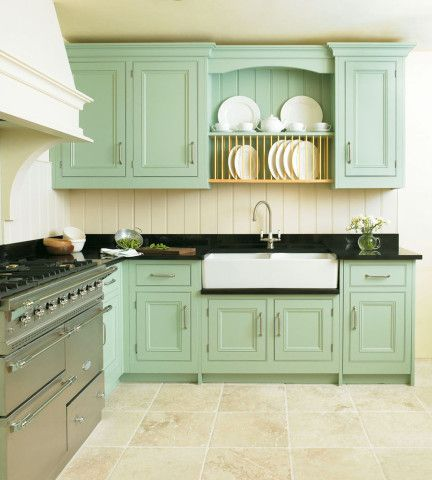 We're swooning over this mint-hued design from Cotteswood of Oxfordshire! We think our Phoenician mixer with filtration looks great with the double sink.