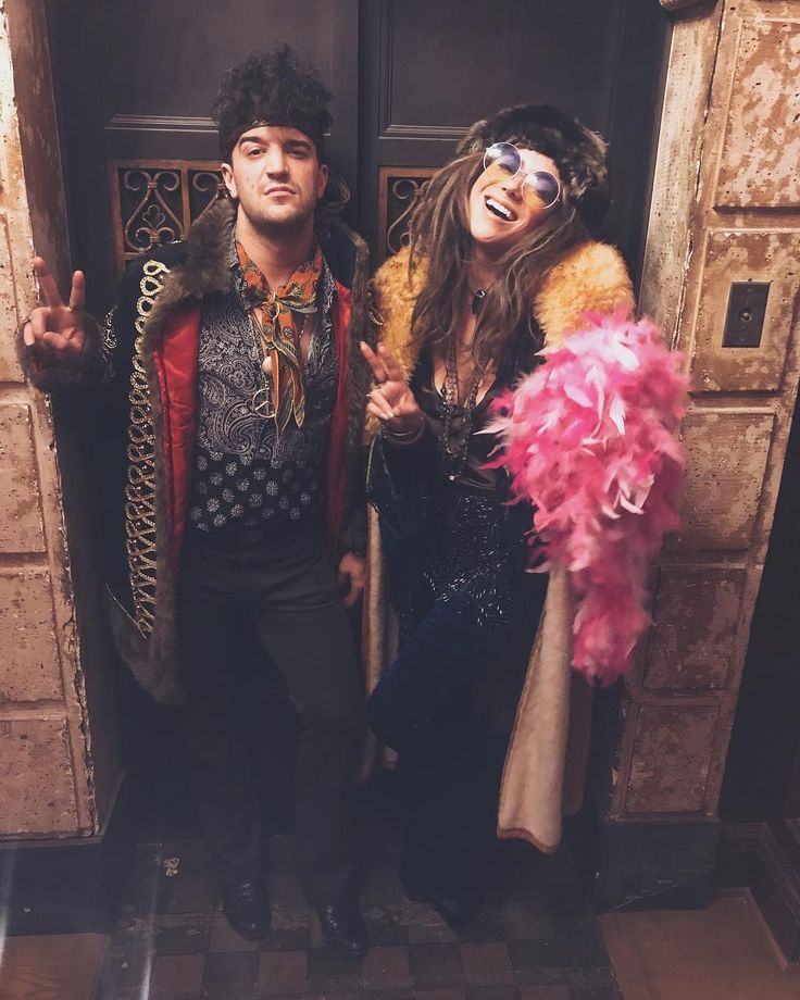 Mark Ballas and BC Jean Halloween costumes - Mark Ballas from Dancing with the Stars and his wife BC Jean dressed up as Jimi Hendrix and Janis Joplin for an October2017 Halloween appearance in which they sang in support ofthe Starlight Children's Foundation.