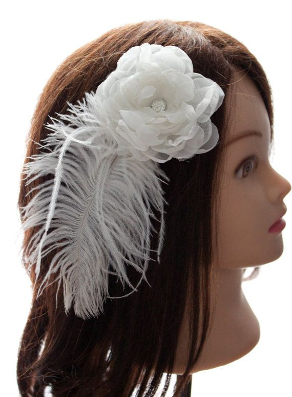 3 inch White Organza Flower, with feathers and alligator clip. The Flower has a silver jewel accent in the middle.