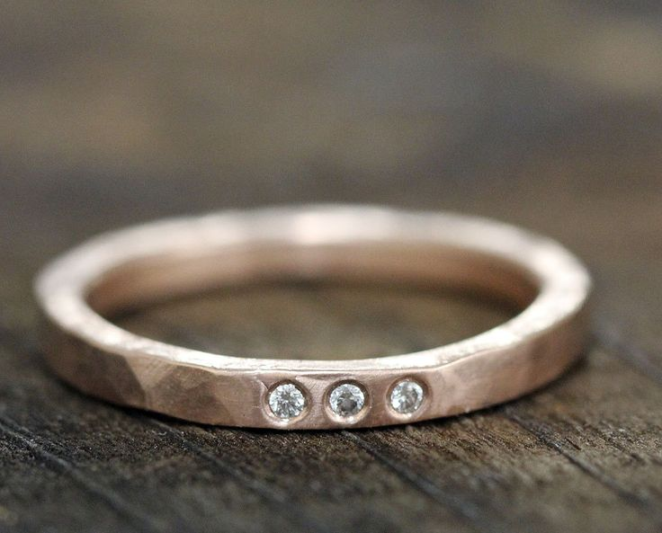 Hammered gold and diamond wedding band.