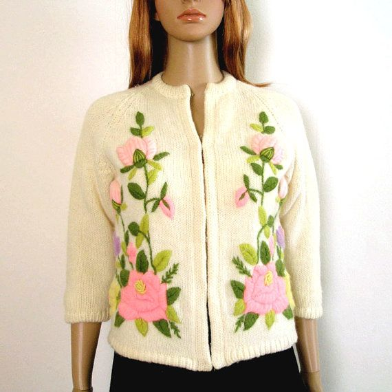RESERVED RESERVED PLEASE DO NOT PURCHASE UNLESS YOU ARE TERRY!    1950s 1960s Sweater Cardigan Crewel Embroidered ROSES on Creamy White. Need a touch of Spring? This beautiful late 50, possibly early 60s, cardigan sweater is covered in roses and flowers of pale pink, rose pink, lavender, yellow, and deep, rosy red, with moss green and dark green leaves and vines. The top rosebuds are 3D puffy.  - No maker, size, or content tags, but would best fit a modern Small to Medium. - Knit feels like…