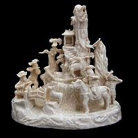 KANGXI 1662 - 1722. Blanc de Chine Porcelain..A Rare Chinese Export Porcelain Blanc de Chine Group of Europeans Hunting, Kangxi Period c.1690 - 1720, from the Dehua Kilns in Fujian Province. Depicting Two Europeans in Tricorne Hats Steadying their Aim with their Pistols Over their Bent Arms. A Further European with a Tricorne Hat Also Takes Aim at the Deer.