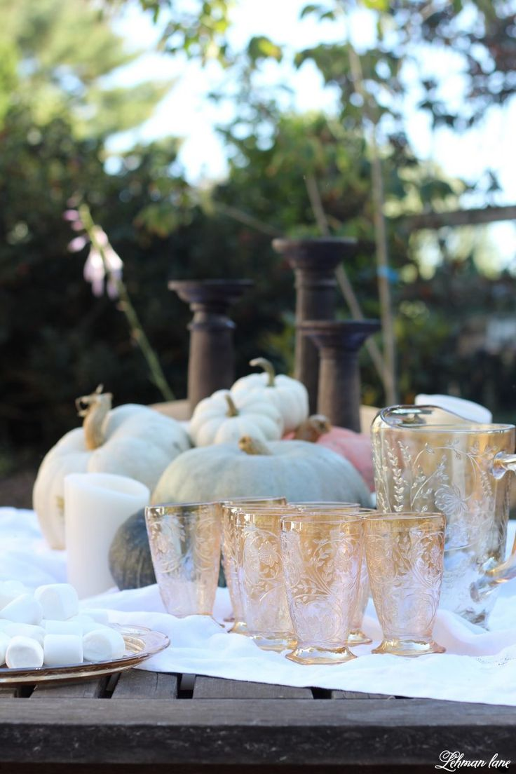 Stop by to see our fall patio and see even more beautiful outdoor spaces from my friends! #fall #falldecor #falloutdoors #fallpatio http://lehmanlane.net - pumpkins, candles and antique glassware