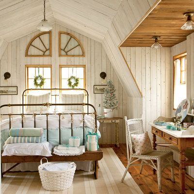 In this master bedroom, the Christmas spirit is alive with mini wreaths hung with seaglass-blue ribbon, a tiny bedside tree, and a handmade sea star and shell rope garland hung from the antique bed.