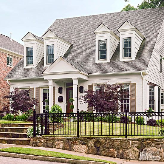A fresh paint job and simple structural changes such as a new portico brought the home into the spotlight, but the second phase of the makeover -- landscaping the sloped front yard -- really helped the home look stunning on its property.
