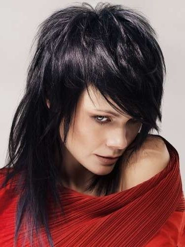 """Very Joan Jett """"I love Rock n Roll"""" style.   But not as extreme, keep the length."""
