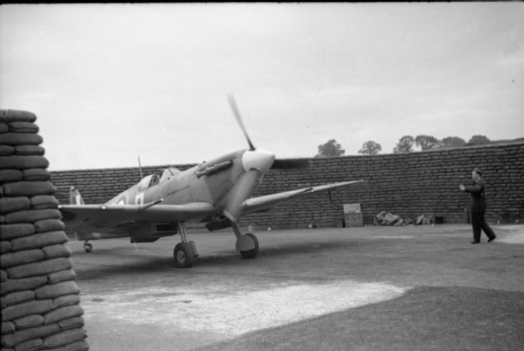 A pilot of No. 313 (Czechoslovak) Squadron RAF, runs up the engine of his Supermarine Spitfire Mark VB in a sandbagged revetment at Hornchurch, Essex.