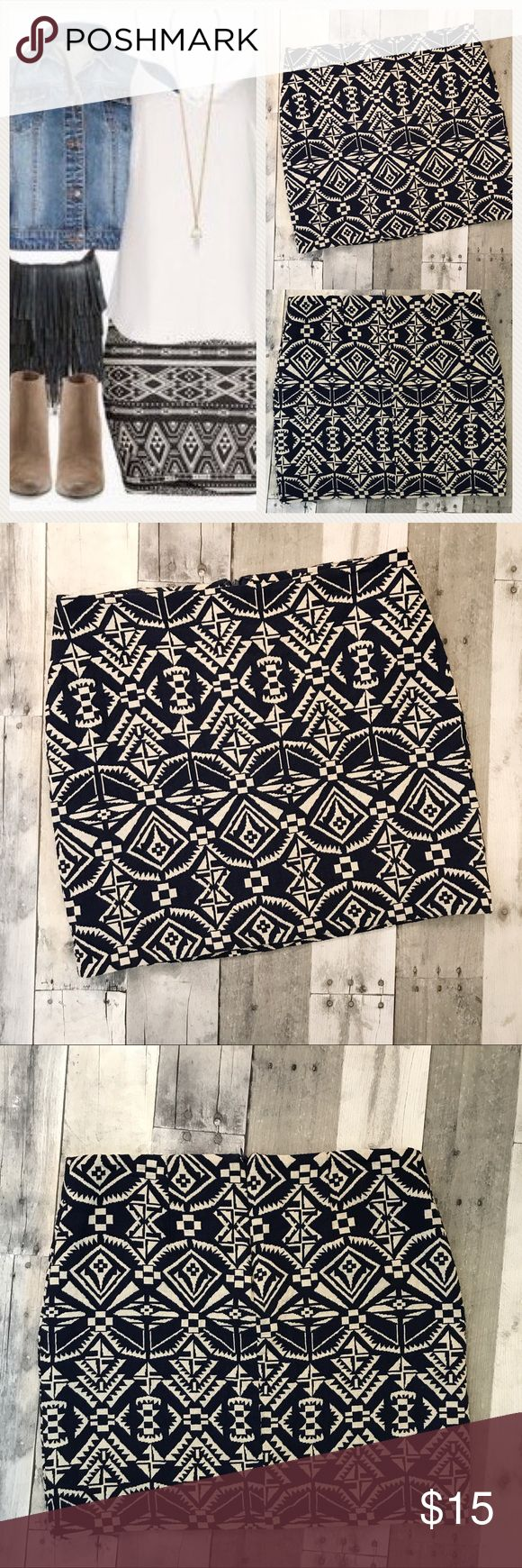 """Forever 21 Tribal Print Skirt, Sz M Navy and Off-White tribal print skirt Hidden zipper in back Fully lined. (The lining is slightly longer than the skirt. The lining just needs to be snipped off or hemmed) It's a really cute skirt. The fabric is soft but textured. I wish this one was my size. Shell 100% Cotton Lining 100% Polyester  *All measurements are approximate. I do my best to be accurate. Waist 15.5"""" Length 15.75""""  *Stock and modeled photos are for style inspiration only. They are…"""